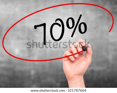 Man Hand writing 70% with black marker on visual screen. Isolated on grey. Business, technology, internet concept.