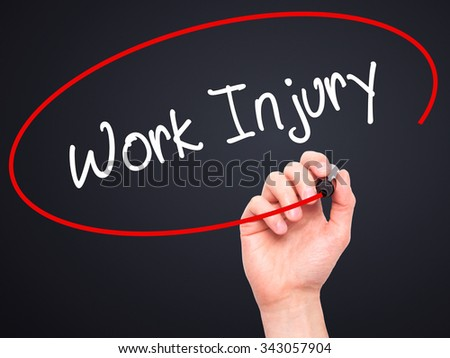Man Hand writing Work Injury with black marker on visual screen. Isolated on black. Business, technology, internet concept. Stock Photo - stock photo
