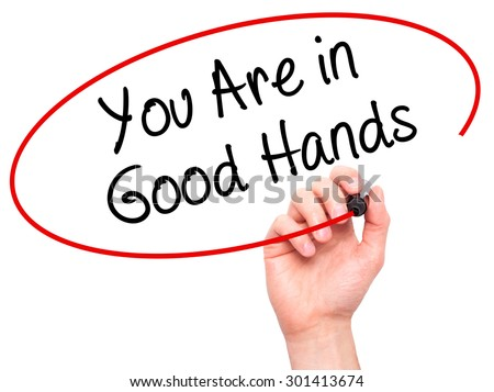 Man Hand writing You Are in Good Hands with black marker on visual screen. Isolated on white. Business, technology, internet concept. Stock Photo - stock photo