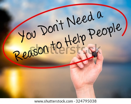 Man Hand writing You Don't Need a Reason to Help People with black marker on visual screen. Isolated on nature. Business, technology, internet concept. Stock Photo - stock photo
