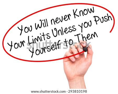 Man Hand writing You Will never Know Your Limits Unless you Push Yourself to Them with black marker on visual screen. Isolated on white. Business, technology, internet concept. Stock Photo - stock photo