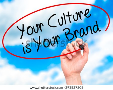 Man Hand writing Your Culture is Your Brand with black marker on visual screen. Isolated on sky. Business, technology, internet concept. Stock Photo - stock photo