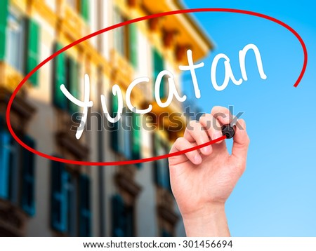 Man Hand writing Yucatan  with black marker on visual screen. Isolated on city. Business, technology, internet concept. Stock Photo - stock photo