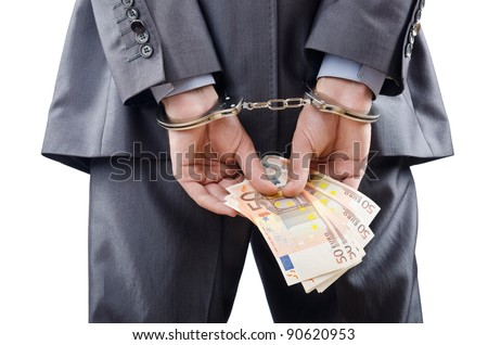 Man handcuffed for his crimes - stock photo