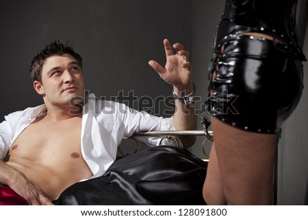 Man handcuffed to the bed during sexual games - stock photo