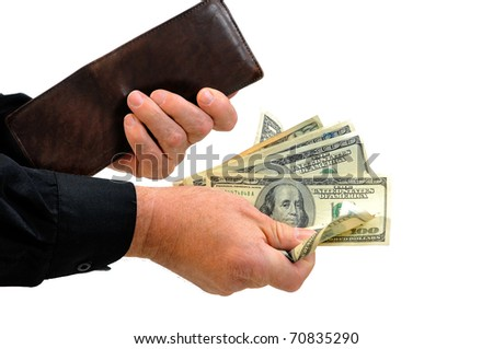 Man handing money. Empty wallet conveys notion that he gave all the money he had. Photographed over white background. - stock photo