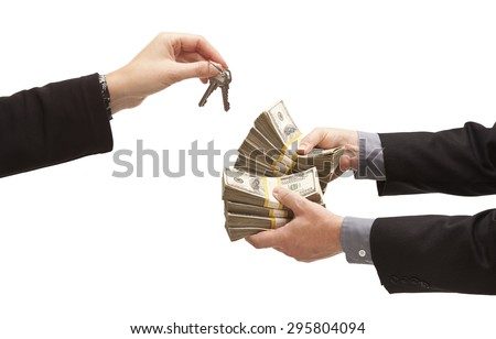 Man Handing Over Thousands of Dollars for House Keys Isolated on a White Background. - stock photo