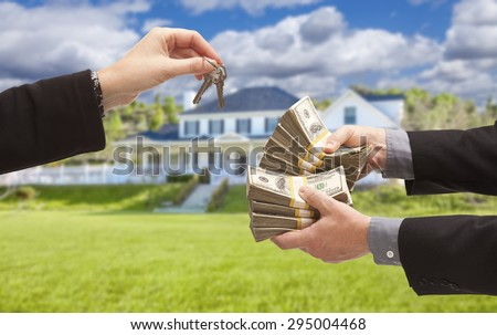 Man Handing Woman Thousands of Dollars For Keys in Front of House. - stock photo
