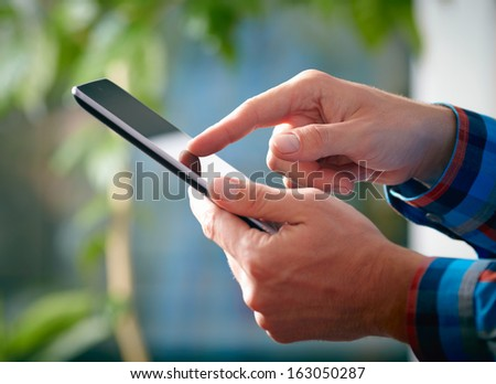 Man hands and tablet PC