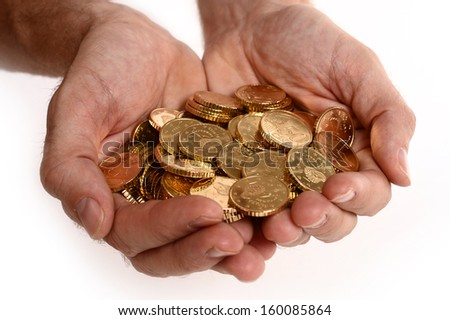 Man hands full of euro coins isolated on white background
