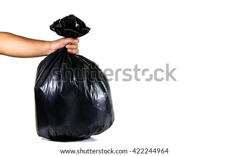 Man hands holding a garbage bag already separate for recycle isolated on white background - stock photo