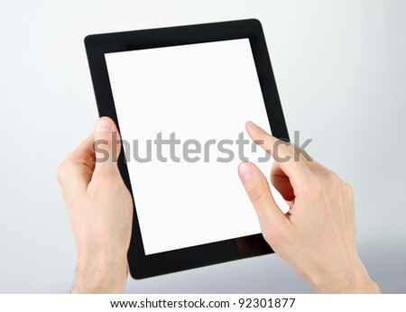 Man hands holding and point on modern electronic digital frame with blank screen.