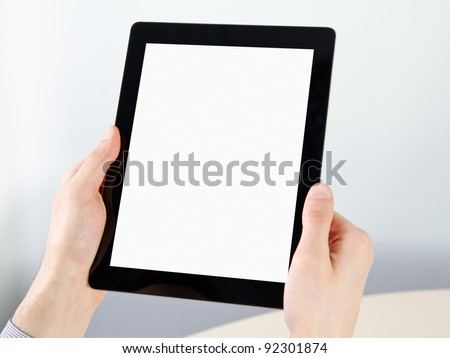 Man hands holding electronic digital frame with blank screen.