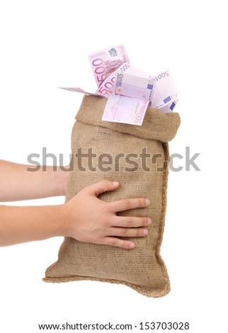 Man hands holding money bag full with euro bills - stock photo