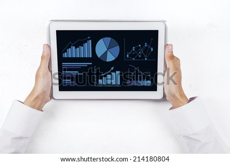 Man hands holding the digital tablet with business chart on a screen