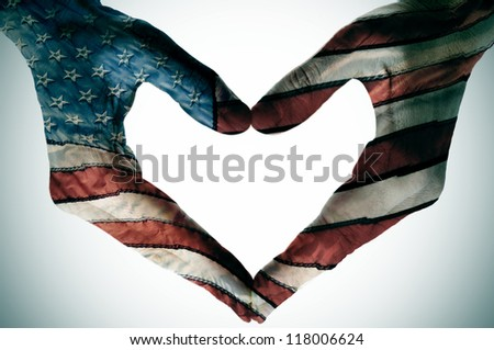 man hands painted as the american flag forming a heart - stock photo