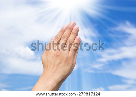 man hands praying on blurred of blue sky backgrounds with ray light.power of life conception:strength together conceptual:assistance and support:faith and belief of humanity.doctrine religious concept - stock photo