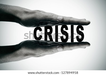 man hands pressing the word crisis, in black and white - stock photo