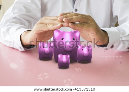 Man hands protect piggy bank. Finance concept of savings or good credit.