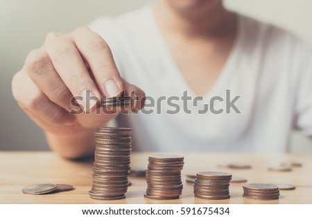 Man hands putting coins stack, Concept business finance saving money and investment