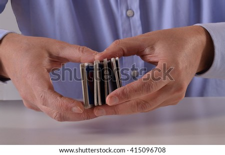 Man hands shuffling game cards - stock photo