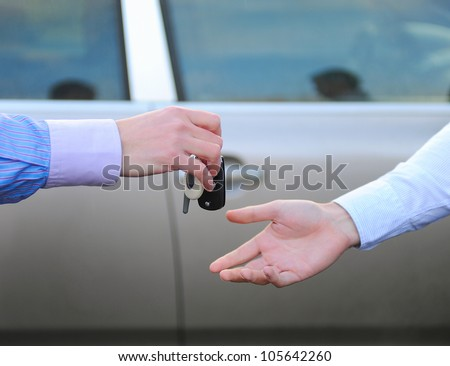 man hands the keys to the car - stock photo