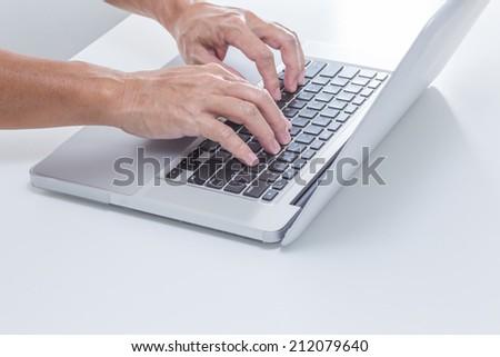 Man hands typing laptop keyboard - stock photo