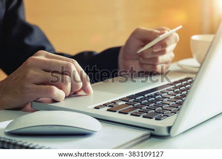 Man hands using laptop and holding credit card with social media as Online shopping concept in morning light