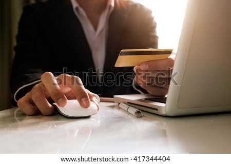 Man hands using laptop and holding credit card with social media as Online shopping concept in morning light  - stock photo