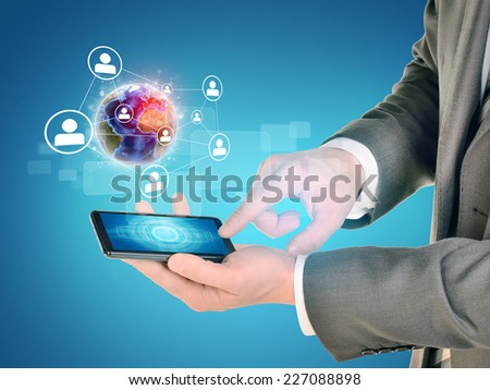 Man hands using smart phone. Earth and network near phone. Element of this image furnished by NASA