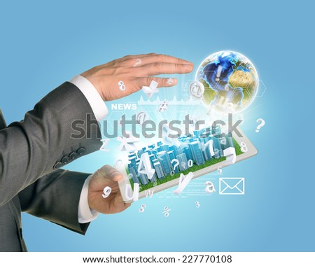 Man hands using tablet pc. Business city on touch screen. Earth near tablet. Element of this image furnished by NASA
