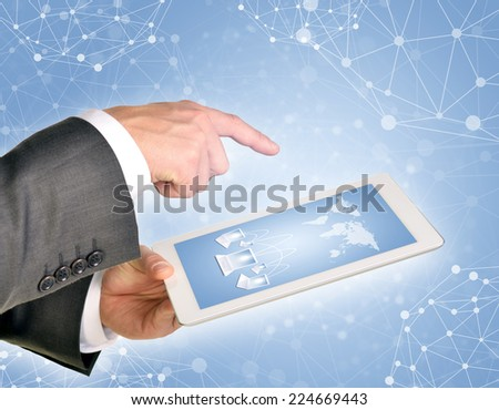 Man hands using tablet pc. Image of world map and laptops on tablet screen