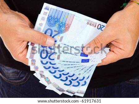 man hands whith euro bills, studio shot - stock photo