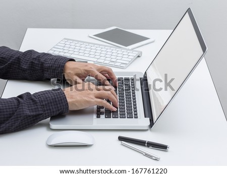 Man hands working on laptop computer