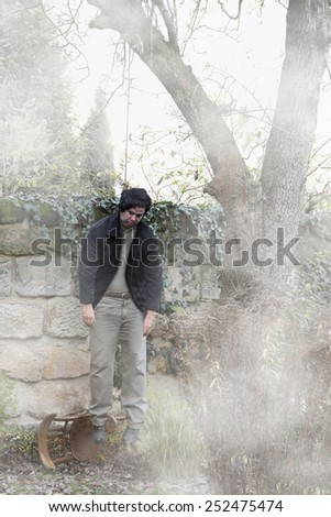 man hanging on a tree - stock photo
