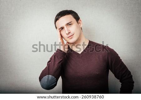 man has a headache - stock photo