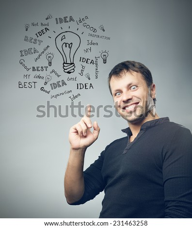 Man has an idea on grey background, doodle drawing - stock photo