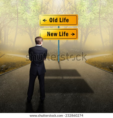 man has to decide to go on the old or the new way of life  - stock photo