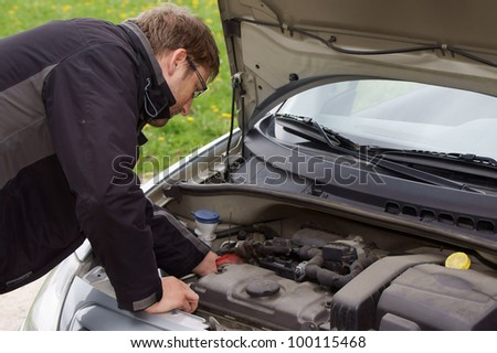 Man have problems with car - stock photo