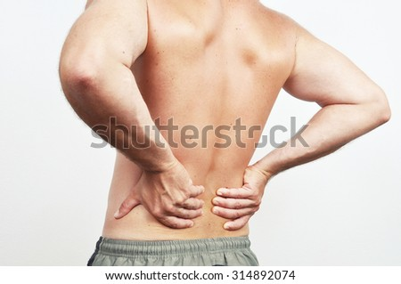 Man having a backache isolated on white - stock photo