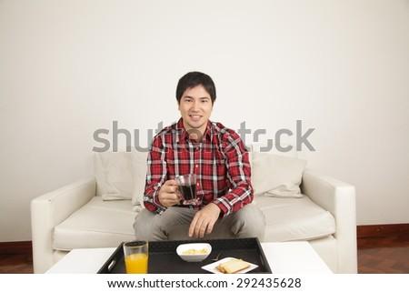 Man having a breakfast - stock photo
