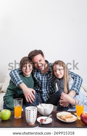 Man having a breakfast with your two childrens