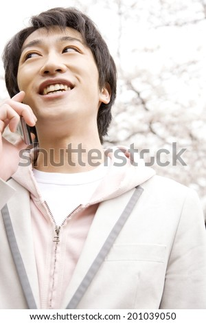 Man having a conversation on the mobile phone - stock photo