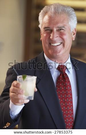 Man Having A Drink At A Bar - stock photo