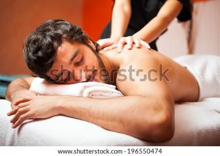 Man having a massage in a wellness center - stock photo