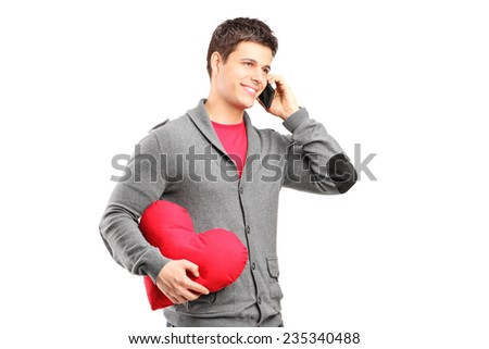 Man having a romantic conversation on the phone isolated on white background - stock photo
