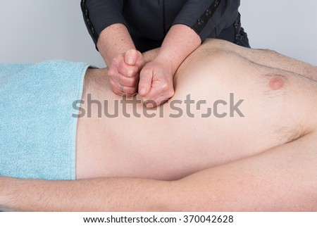 Man having a visceral massage. Close-up in a spa center