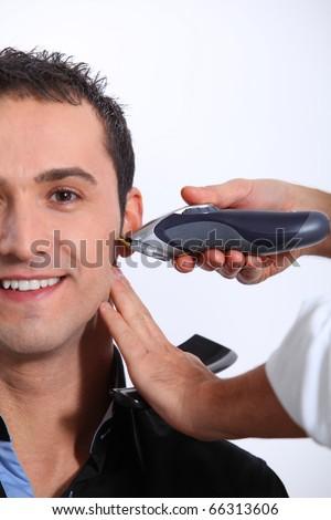 Man having an haircut - stock photo