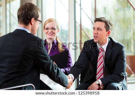 Man having an interview with manager and partner employment job candidate hiring resume CEO work business shaking hands