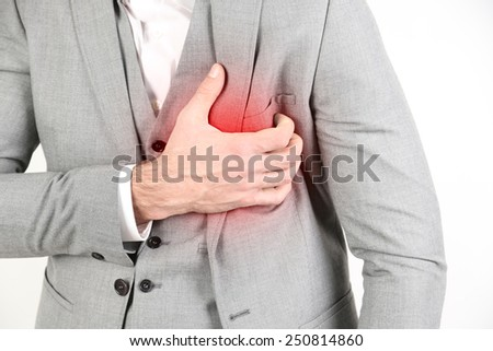 Man having chest pain - heart attack close up - stock photo
